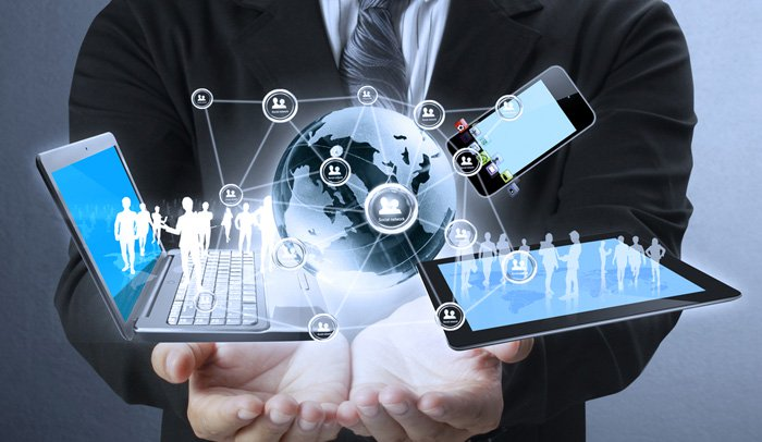 Business Man Holding a Computer and devices displayed on a futuristic interface with interantional network - Modern Communication and technology concept